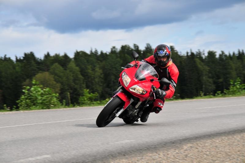369141-motorcycle-speeding-motorcycle